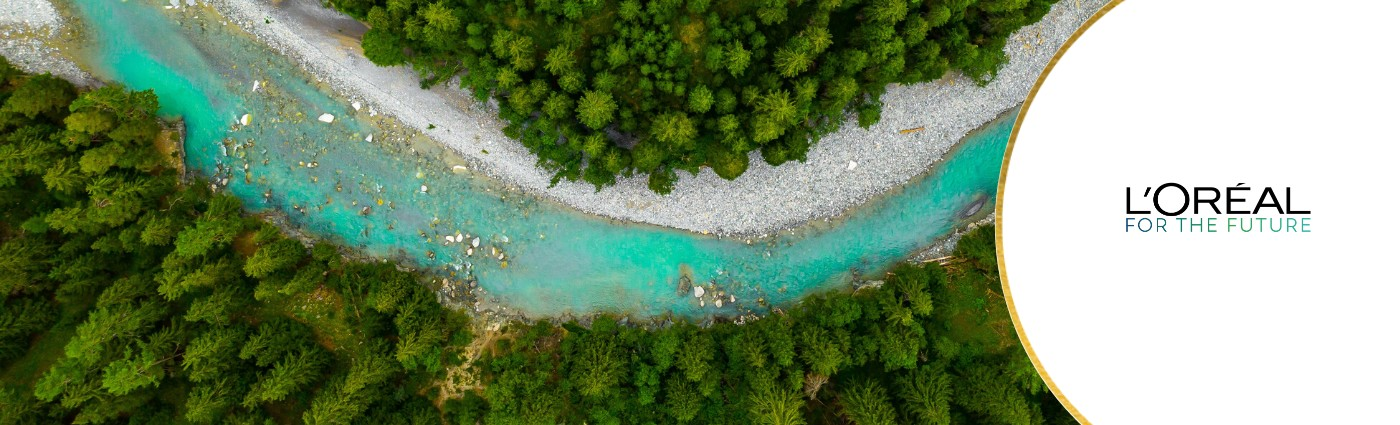 Image of river between lush landscape, Loreal for the future branding featured to the side